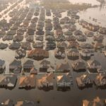 An aerial image of dozens of homes experiencing severe flooding
