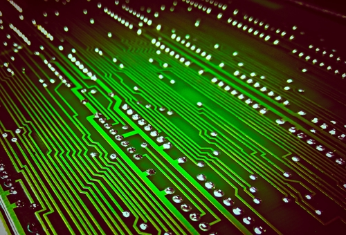 the circuitry of a motherboard is pictured very closely